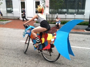 Picture of a decorated bike leading the art car parade at Baltimore's Artscape 2014