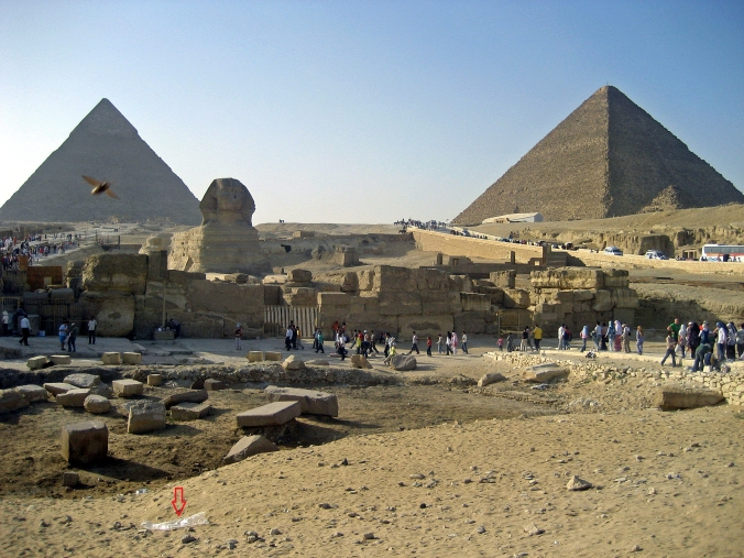 Picture of pyramids, sphinx, and litter in Giza, Egypt