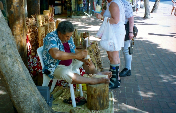 Picture of man carving a tiki in honolulu, hawaii